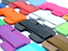 The Minimo is a stylish wallet made up of three metal plates held together by a silicone band and can be put together into thousands of color combinations!