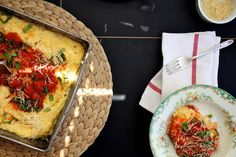 Baked Polenta with Tomato and Basil (substitute the butter and cheese for vegan alternatives and this looks really good!)