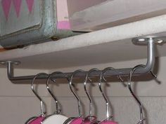 Hang towel rods upside down to use as unexpected hanging storage in the laundry room or a broom closet..