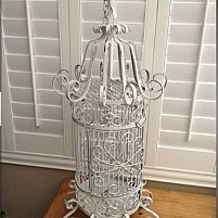 Garage sale Vintage Birdcage restored. Sanded it down, primed, painted and distressed it.