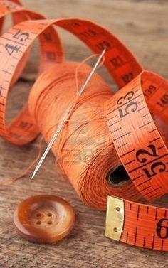 orange tape measure and thread