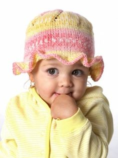 This darling baby hat knitting pattern features a sweet little ruffle around the edge to guard baby's face from the sun.