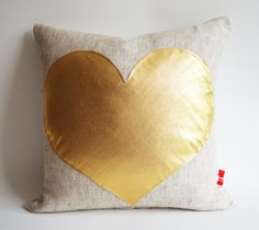 Sukan / Gold Heart Pillow Cover - Raw Linen Pillow - Decorative Pillow - Accent Pillow - Valentine Day Gift - 16x16 Pillow Cover. $35.60, via Etsy.