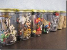 Empty plastic jars (almond butter from Costco) cleaned up and turned into toy storage.