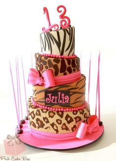Gorgeous Tiered Topsy Turvy #Cake with different #Animal Print on each tier! We totally love and had to share! Great #CakeDecorating!