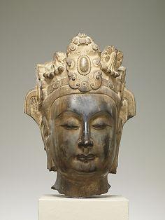 Head of an Attendant Bodhisattva    Period:      Northern Qi dynasty (550–577)  Date:      ca. 565–75  Culture:      China  Medium:      Limestone with pigment