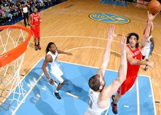 Luis Scola shows off his left hand vs. the Nuggets