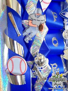 Sports-themed homecoming mum and garter idea:  Decorate with sports trinkets and don't forget Sports Roses too!  Available online at http://sportro.se/mums-garters