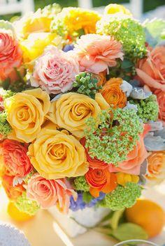 Such a gorgeous arrangement of citrus colors floral centerpieces, citrus wedding, color schemes, happy colors, wedding flowers, wedding colors, fresh flowers, floral arrangements, wedding centerpieces