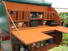Custom Teardrop with full galley; countertop collapses down to secure lower cubbies