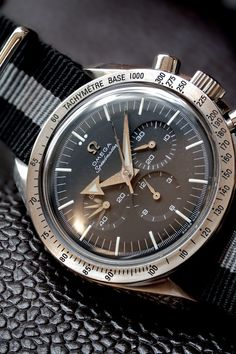 """New watch reliability and warranty with a vintage look. Omega Speedmaster Broad Arrow """"Re-issue"""". Ref. 3594.50. 42 mm. (No longer available from Omega.) More info. can be found here: http://www.omegawatches.com/gents/speedmaster/broad-arrow/35945000"""