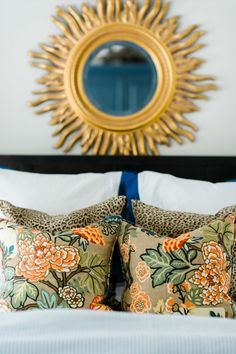 Amazing toss cushions & sunburst mirror | Photography: Caroline Lima Photography - www.carolinelima.com  Read More: http://www.stylemepretty.com/living/2014/09/02/behind-the-blog-emily-a-clark/