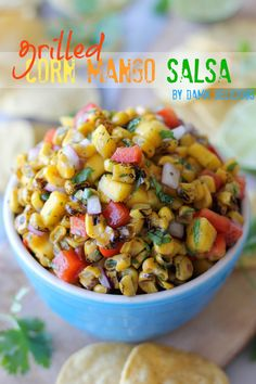 Grilled Corn and Mango Salsa. I just bought fire-roasted frozen corn at trader joes today! It's meant to be!