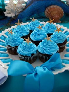 Under the Sea Cupcakes.  This is such a cute idea for the under the sea baby shower or nautical theme.