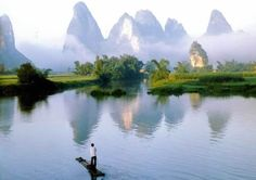 """Guilin Hills China - """"Guilin is said to be one of the most beautiful cities of China, different from the rest of the country due to its unusual history and natural isolation."""""""