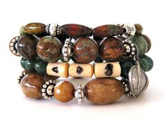 Earthy beaded stretch bracelets (4 in all!) featuring 12mm Australian green opal beads, large ceramic barrel beads, 8mm moss agate beads, Australian turquoise tube beads, amber shell beads, cream/white 10mm faceted agate beads, cream wood beads and pewter accent beads including a leaf charm. A stunning handmade bracelet set that exudes an earthy, nature-loving vibe perfect for those Boho chic outfits everyone will be wearing this spring and summer.