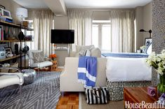 I love spotting fabrics we have in the store in national magazine spreads. At least two Lacefield design fabrics, and one of them is my Monaco in Linen.  From House Beautiful July/August issue. Yes, 400 Square Feet Can Feel Spacious. Here's How.