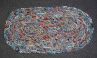 Love it! This gal used plastic packaging instead of plastic grocery bags for her plarn rug (bread bags, etc)