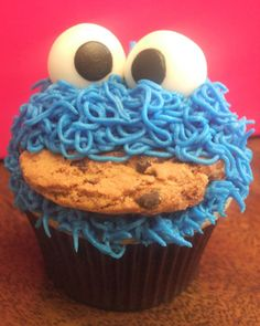 Cookie Monster cupcake - made these for a first birthday, but I used a Wilton #233 tip (gives you 11 streams of icing instead of one), used marshmallows and black icing for the eyes (similar to the elmo cupcakes on this board) and I cut the cookies in half to stick in the icing.  They loved them!