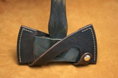 Double-bitted axe sheath. Really beautiful.