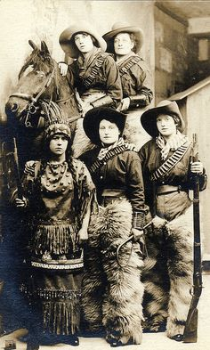 Another souvenir from London by lovedaylemon, via Flickr. There's some fine posing going on here. At a fancy dress studio.