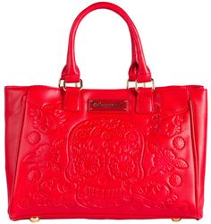 LOUNGEFLY RED EMBOSSED SUGAR SKULL TOTE Loungefly has the perfect purse to bring a little pop 'o color to your wardrobe! This bright cherry red, faux leather handbag features an embossed sugar skull & floral design on one side, round metal feet, sturdy handles, magnetic button closure & gray & white polka dotted lining. $64.00 #loungefly #tote #totebag #sugarskull #cherryred #embossed