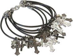 DIY jewelry project called Baptized by Fire Bracelet with  light, dark and crystal crosses and black leather.