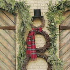 Create a snowman using 3 different sized grapevine wreaths (available at craft stores) tie a scarf and complete with a top hat.