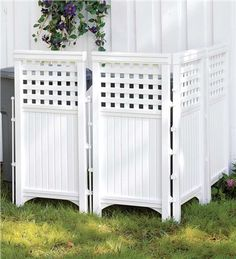 from Plow and Hearth --  hide the A/C unit or the trash cans, $120 made of resin with steel hinges.