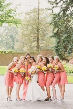 Coral bridesmaid dresses with yellow bouquets!  | Event Planning: Hey Gorgeous Events - heygorgeousevents.com | Photography: Abby Rose Photo - abbyrosephoto.com  Read More: http://www.stylemepretty.com/2014/05/16/heart-themed-summer-wedding/