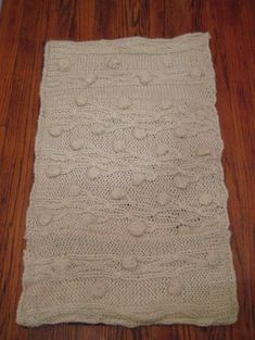 Make a rug from an old sweater.  http://www.homeworkshop.com/2009/11/07/recycled-sweater-rug/