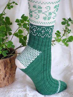 HeartStrings Beaded Shamrocks Socks knitting pattern celebrates St. Patrick's Day and springtime. Beaded shamrocks and crosses decorate cuff and ankle. $7.00