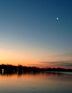 """Jennifer Dust took this photo of Walled Lake in March 2011. """"The attached photo was taken early in the morning,"""" Dust wrote. """"Capturing both an early sunrise and the moon setting over Walled Lake."""" Dust added that: """"Living in Oakland County gives one many pleasures of all kinds."""""""