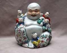 Ceramic Chinese figures: happy buddha with 5 children