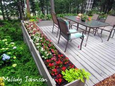 Use raised beds to enclose a deck