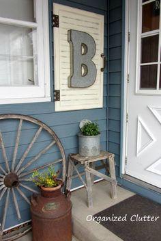 Outdoor Junk Vignette with Cabinet Door Project Tutorial www.organizedclutterqueen.blogspot.com