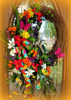 "Super Colorful wreath, Reds, Yellows, Purple,Orange and White....30"" in height from top of greenery to bottom of greenery. http://www.primitivehomedecorandmore.com/"