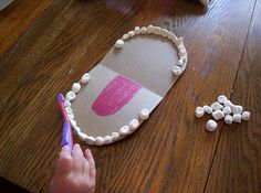 Teeth brushing craft with marshmallows (how ironic, eh?)