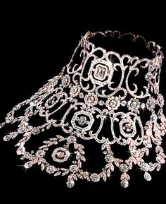 Bib necklace worn by Nicole Kidman in Moulin Rouge.  The necklace is made of diamonds and platinum and is the most expensive piece of jewelry ever specifically made for a film.  The Stefano Canturi necklace was made with 1,308 diamonds, weighing a total of 134 carats.  The piece was to be auctioned off at the end of filming, but was withdrawn before bidding commenced.