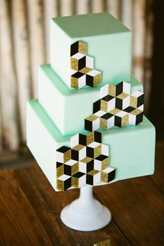 Mint, gold, and black geometric wedding cake