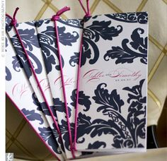 The cover of the ceremony programs had a navy floral fern print along with the couple's names and wedding date. Each was tied with peony pink ribbon.