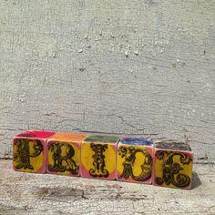 Rainbow Pride Wooden Blocks on Etsy, $45.00 CAD