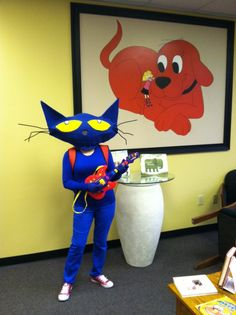 Scholastic Book Fair employee dressed as Pete the Cat, from the popular picture book series.