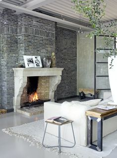 Architect John Guy van Keulen converted a studio complex in Amsterdam in a wonderful place to live. The old castle fireplace was purchased in Belgium. (photo: Tjitske van Leeuwen)