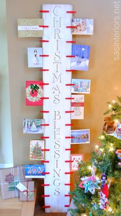DIY: Easy-to-create Christmas Card Holder with 6' piece of wood and clothes pins by @Jenna_Burger via sasinteriors.net #LowesCreator #LowesCreativeIdea