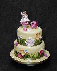 Lovely two tier fairy cake.  For more information visit www.cakeglam.com