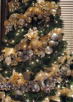 silver and gold christmas tree. garland christmas decor balls.