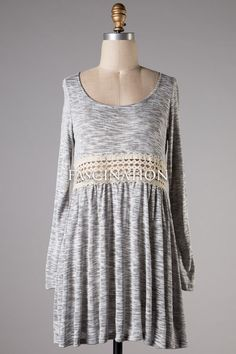 Perfect to wear with those cowgirl boots. Knitted loose fitting dress with a crochet waistline detail. Made of 70% rayon and 30% polyester. Fits true: Small 2/4, Medium 4/6, Large 8/10