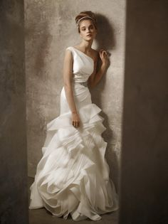 A uniquely elegant wedding gown. Like/follow us at My Wedding Style on Pinterest for more amazing ideas.