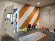 Another standout area in the basement is this Cross Fit gym, equipped with kettlebells, a medicine ball, jump ropes, and a yoga mat--> http://hg.tv/vb1n